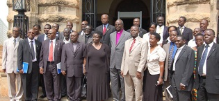 A group photo with His Grace Henry Luke Orombi, Archbishop of the Church of Uganda during his visit, 24th August 2011, Makerere University, Kampala Uganda