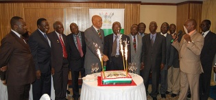 Chancellor Prof. G.M. Kagonyera (C) cuts the commemorative cake with some of the 14 Professors as Acting Vice Chancellor, Prof. V. Baryamureeba (L) and Chairperson Council, Eng. Dr. C. Wana-Etyem (2nd L) join in, 20th July 2012, Kampala Serena Hotel, Uganda