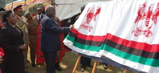 Presidents Mwai Kibaki of Kenya (L) and Yoweri Kaguta Museveni of Uganda (R) unveil the plaque symbolizing the Launch of Constituent Colleges on 24th January 2012, Makerere University, Kampala Uganda