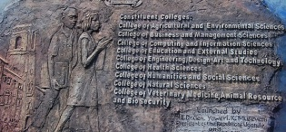 The artwork of the plaque symbolizing the Launch of Constituent Colleges on 24th January 2012, as designed by Assoc. Prof. George Kyeyune, MTSIFA, CEDAT, Makerere University, Kampala Uganda
