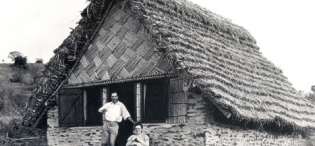 Dr and Mrs Schjofield outside Bweranyangi European Rest House at C.M.S. Church-Stone plaited work with thatch (Ankole)