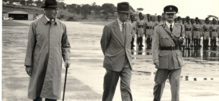 The Earl of Perth and Minister of State for Colonial Affairs (1957-62) Mr. J.D. Drummond inspects the Police Parade at Entebbe on 11th April 1959 during his tour of Uganda and Kenya