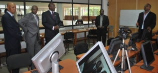 L-R Chancellor Prof. Kagonyera, Chairperson Council Hon. Rukikaire, ICT Minister Hon. Ham Muliira receive a guided tour of the Multimedia Lab by Senior PRO Gilbert Kadilo and CIT Head of Corporate Relations Michael Niyitegeka, CIT, 28th January 2009