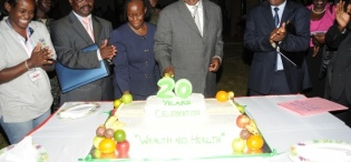 President Museveni flanked by Hon. Mwesigwa-Rukutana (2nd L), Dr. Tibatemwa-Ekirikubinza (3rd L) and Dr. Muyonga cuts the cake marking the FST 20th Anniversary 2nd October 2009, Makerere University, Kampala Uganda