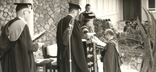 Her Majesty Queen Elizabeth, the Queen Mother then Chancellor University of London confers a Doctorate upon a Member of staff at Makerere Univeristy, Kampala Uganda, 20th February 1959