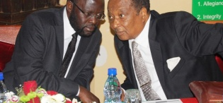 Hon. Prof. Peter Anyang' Nyong'o (L) confers with Rt. Hon. Prof. Apolo Nsibambi during the Re-launch of the Makerere Africa Lecture Series, 2nd December 2011, Makerere University, Kampala Uganda
