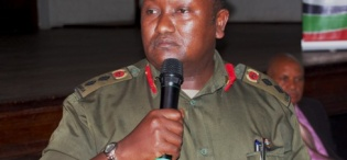Uganda Peoples Defence Forces (UPDF) Spokesman Colonel Felix Kulayigye contributes to the debate during the Re-launch of the Makerere Africa Lecture Series, 2nd December 2011, Makerere University, Kampala Uganda