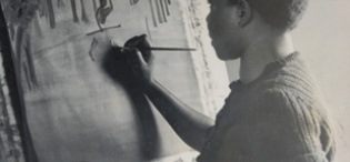 A student paints during the early years of the Margaret Trowell School of Industrial and Fine Arts (MTSIFA) founded in 1937, Makerere University, Kampala Uganda