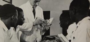 Dr A. Galloway (C) takes his students through an anatomy class, Medical School, Makerere University, Kampala Uganda