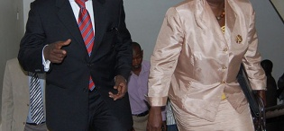 Mr. Ibrahim Kaliisa, Assistant Presidential Advisor on ICT (L) and Hon. Syda Bbumba, Minister of Finance, Planning and Economic Development make their way to the Lab at the National BPO Training Launch, 17th January 2011, CoCIS, Makerere University, Kampala Uganda