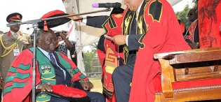 The Chancellor Prof. George Mondo Kagonyera confers the Honorary Doctorate of Laws upon President Mwai Kibaki during the Award ceremony, 24th January 2012, Makerere University, Kampala Uganda