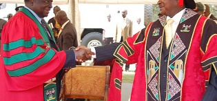 President Mwai Kibaki is congratulated upon receiving his Honorary Doctor of Laws Award by President Yoweri Kaguta Museveni on 24th January 2012, Makerere University, Kampala Uganda