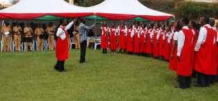 The Prisons Band and students from Performing Arts and Film (PAF), College of Humanities and Social Sciences (CHUSS) sing the Makerere at 90 commemorative song on 4th August 2012, Makerere University, Kampala Uganda