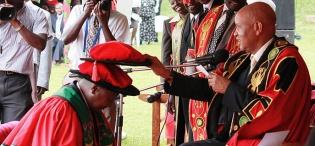 The Chancellor Prof. G.M. Kagonyera confers the Honorary Doctorate of Laws upon H.E. President Yoweri Kaguta Museveni on 12th December 2012, Makerere University, Kampala Uganda