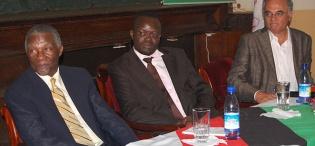 R-L Prof. Mahmood Mamdani-Director MISR, Prof. Venansius Baryamureeba-Ag. Vice Chancellor listen to a participant during President Thabo Mbeki's (L) Public Q&A session on 19th January 2012, Makerere University, Kampala Uganda
