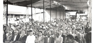 Factory employees and locals listen to Governor of Uganda Sir Fredrick Crawford K.C.M.G, O.B.E address after he opened a plywood factory at Jinja in August 1959