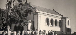 Students leave St. Augustine Chapel Makerere University, Kampala Uganda after Sunday Mass. Completed in 1941, extended in 2005