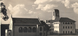 An early picture of St. Francis Chapel, Makerere University, Kampala Uganda with the Main Building in the background. The Chapel was completed in 1941