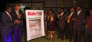 L-R: Chairperson-Council Eng. Dr. C. Wana-Etyem, Chancellor-Prof. G. Mondo Kagonyera, Vice Chancellor-Prof. J. Ddumba-Ssentamu (4th R) and the New Vision Team applaud as the Education Minister Hon. Jessica Alupo launches the Mak@90 Souvenir Magazine during the UEA celebrations, 29th June 2013, Makerere University, Kampala Uganda