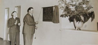 Governor of Uganda Sir Andrew Cohen (R) unveils the tablet to officially open the Uganda Museum's new home at Kitante on 30th June 1954