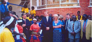 Vice Chancellor Prof. P.J.M. Ssebuwufu (2nd L), Director General NORAD, Ms. Tove Strand (C) enjoy entertainment at the official launch of the  Women and Gender Studies Building on 22nd July 2002, Makerere University, Kampala Uganda as part of the Women's World Congress 2002