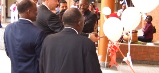 H.E Gjermund Sæther cuts the tape to mark the official opening of Faculty of Technology Extension, Makerere University, Kampala Uganda on 14th August 2009