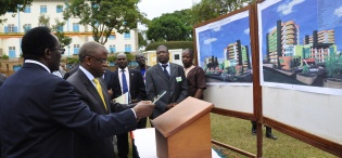 The Prime Minister, Rt. Hon. Amama Mbabazi assisted by the Vice Chancellor, Prof. John Ddumba-Ssentamu lays the Foundation Stone for the proposed Students' Centre at the Mak@90 Grand Finale, 3rd August 2013, Makerere University, Kampala Uganda