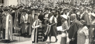 Her Majesty Queen Elizabeth, the Queen Mother then Chancellor University of London makes her way into the Agriculture quadrangle to preside over the Graduation Ceremony at Makerere Univeristy, Kampala Uganda, 20th February 1959