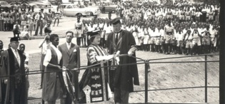Her Majesty Queen Elizabeth, the Queen Mother assisted by the Chancellor cuts the tape to mark the official opening of the New Library Building at Makerere University, Kampala Uganda on 20th February 1959