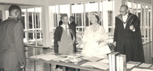 Her Majesty Queen Elizabeth, the Queen Mother, led by the Principal Sir Bernard de Bunsen tours the New Library Building at Makerere University, Kampala Uganda on 20th February 1959