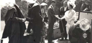 Her Majesty Queen Elizabeth, the Queen Mother is received by The Chancellor, Principal Sir Bernard de Bunsen and Colonial Administration Staff at Makerere University, Kampala Uganda on 20th February 1959