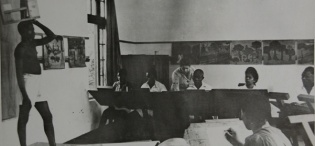 Life Class in Session at the Makerere Art School in 1947 with Margaret Trowell the School Founder instructing students. MTSIFA, Makerere University, Kampala Uganda