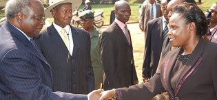 Kenyan President H.E. President Mwai Kibaki accompanied by H.E. President Yoweri Kaguta Museveni is received upon arrival by Education Minister Hon. Jessica Alupo to receive his Honorary Doctorate of  Laws Award, 24th January 2012, Makerere University, Kampala Uganda