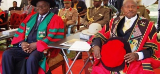 President Yoweri Kaguta Museveni (R) and President Mwai Kibaki of Kenya (L) at the latter's Honorary Doctor of Laws Award ceremony, 24th January 2012, Makerere University, Kampala Uganda